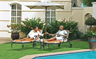 Couple On Loungers At The Pool