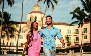 Couple Walking in Front of the Southern Sun Maputo Hotel