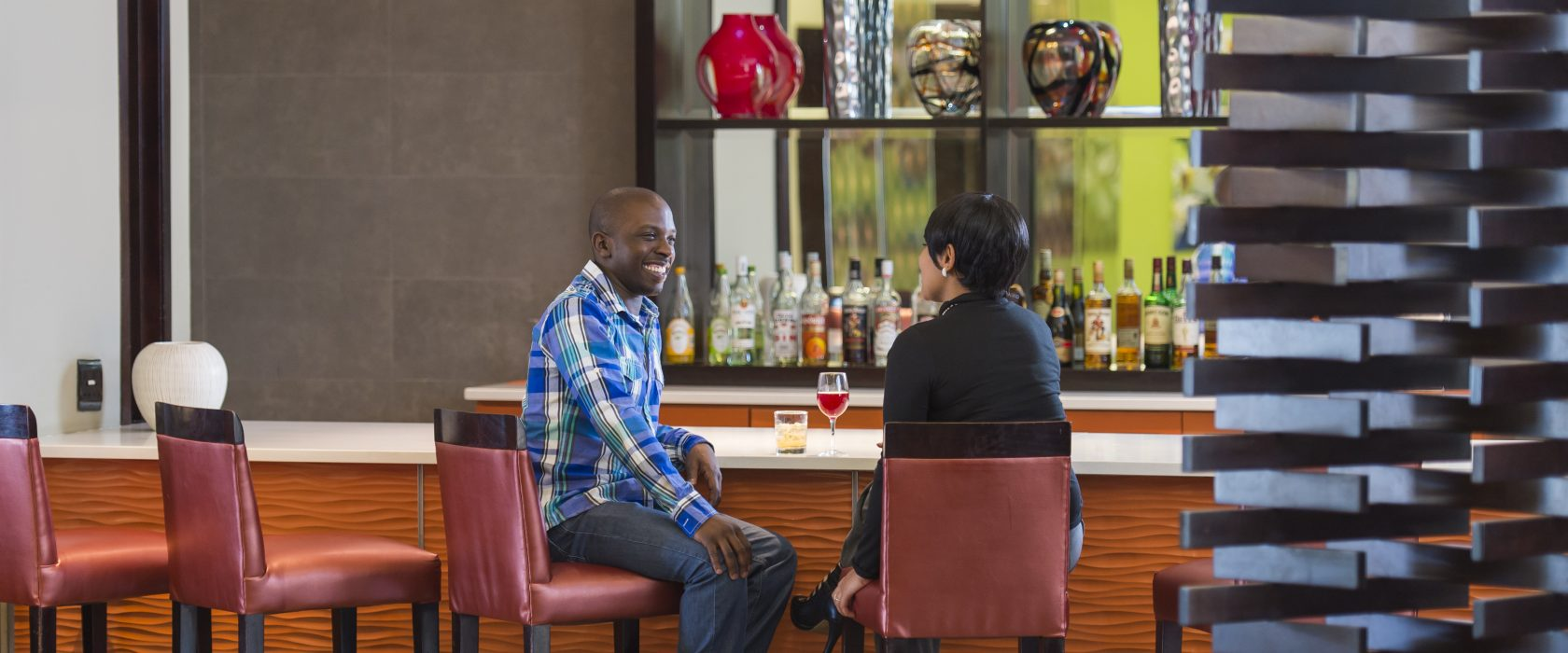 Couple enjoying drinks at the bar in the StayEasy hotel Lusaka