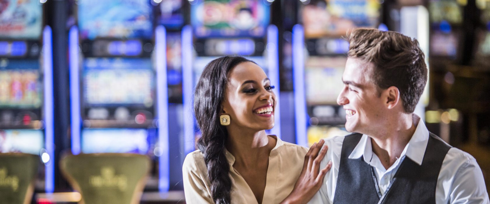 Couple By Slot Machines
