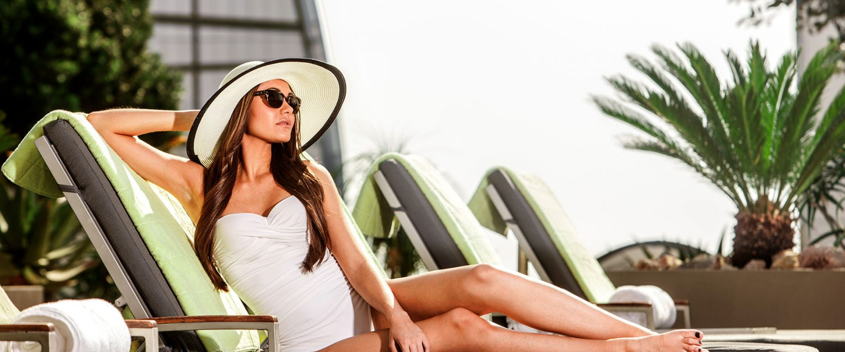 Woman On Poolside Lounger