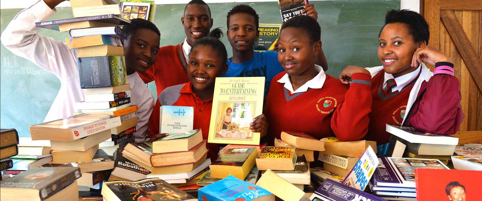 Children Surrounded By Books As Part Of Tsogo Sun Learnership