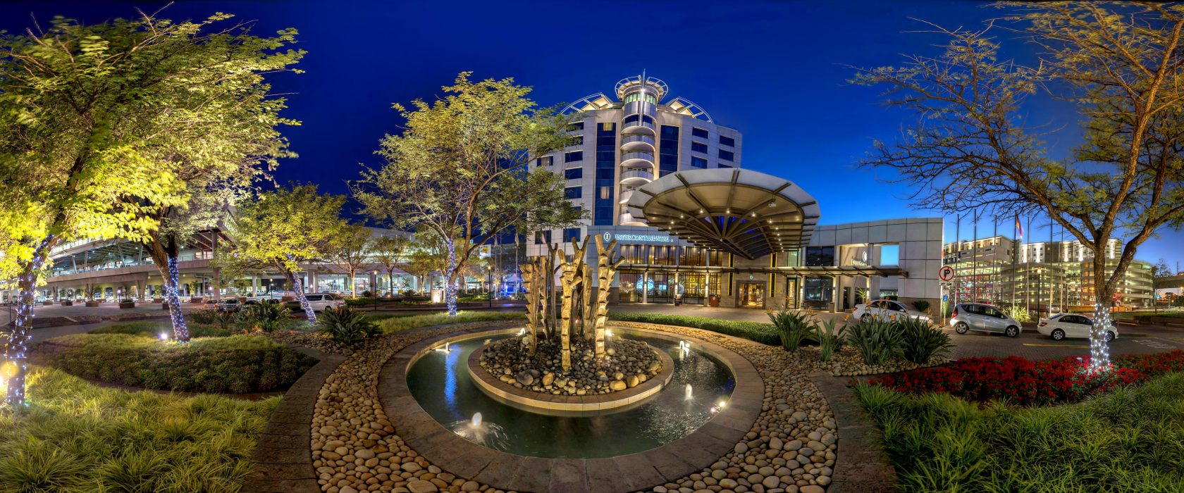 Panoramic View Of The Hotel Exterior And Gardens