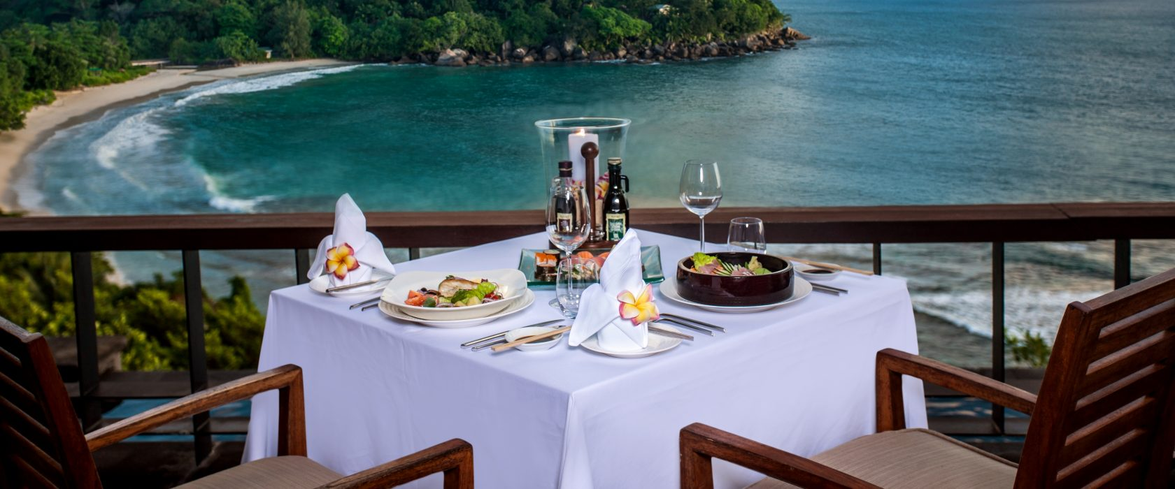 Dining On A Terrace Overlooking The Ocean And Island