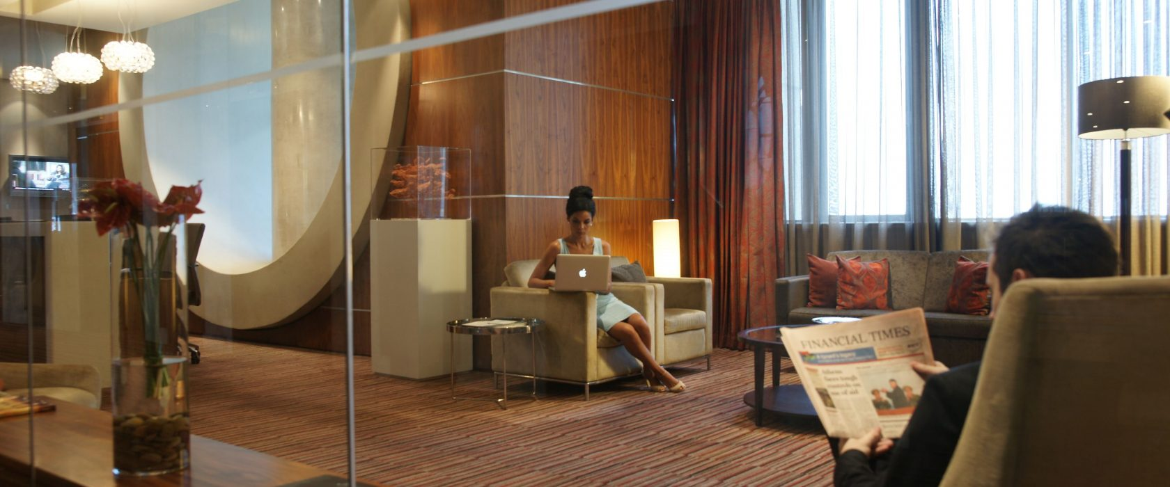 Woman And Man In The Business Suite Lounge