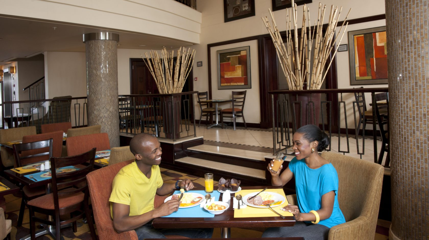 A couple enjoying breakfast in the breakfast room at StayEasy Emalahleni hotel