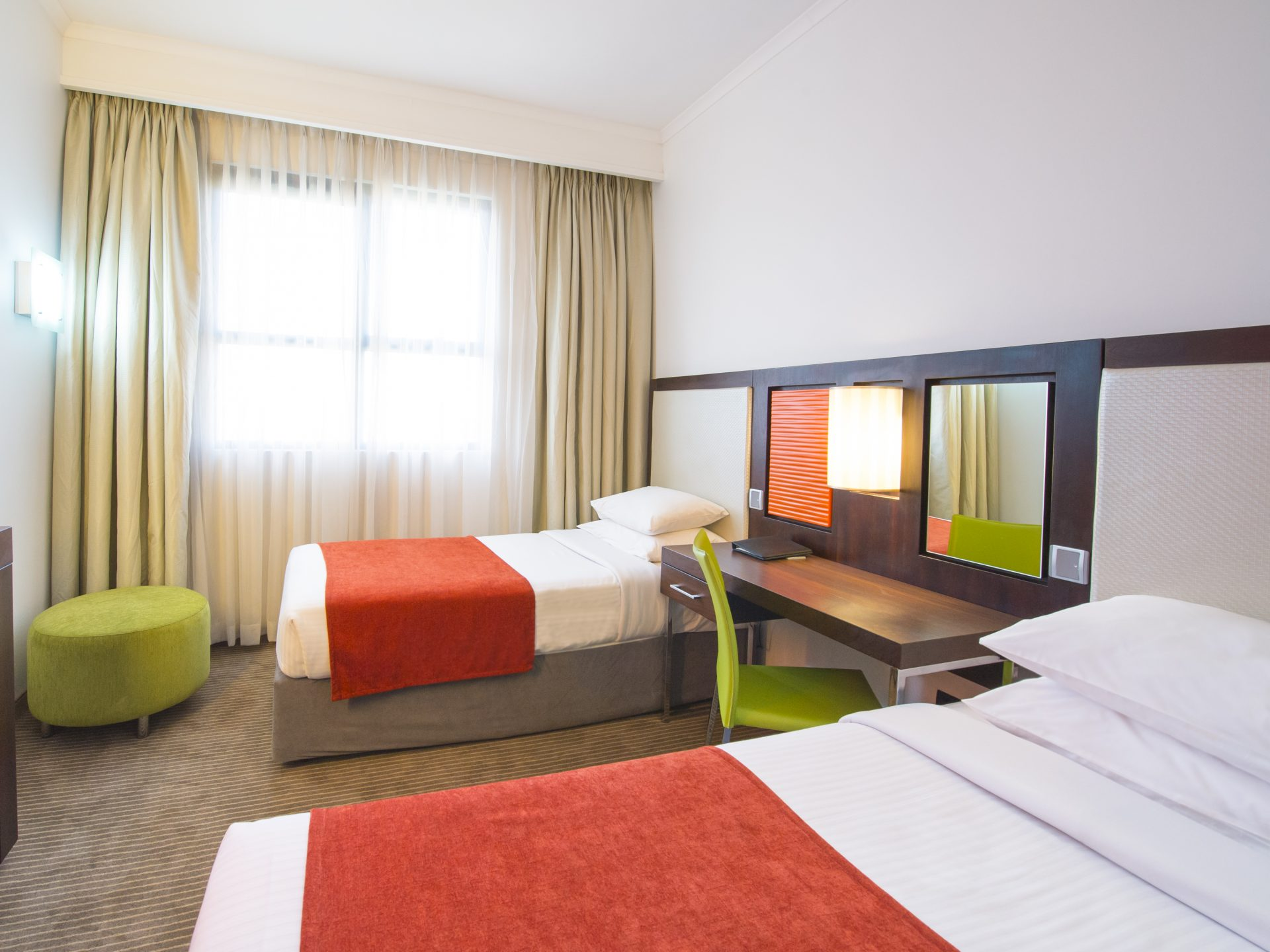 A Standard Room with two single beds at StayEasy hotel Lusaka