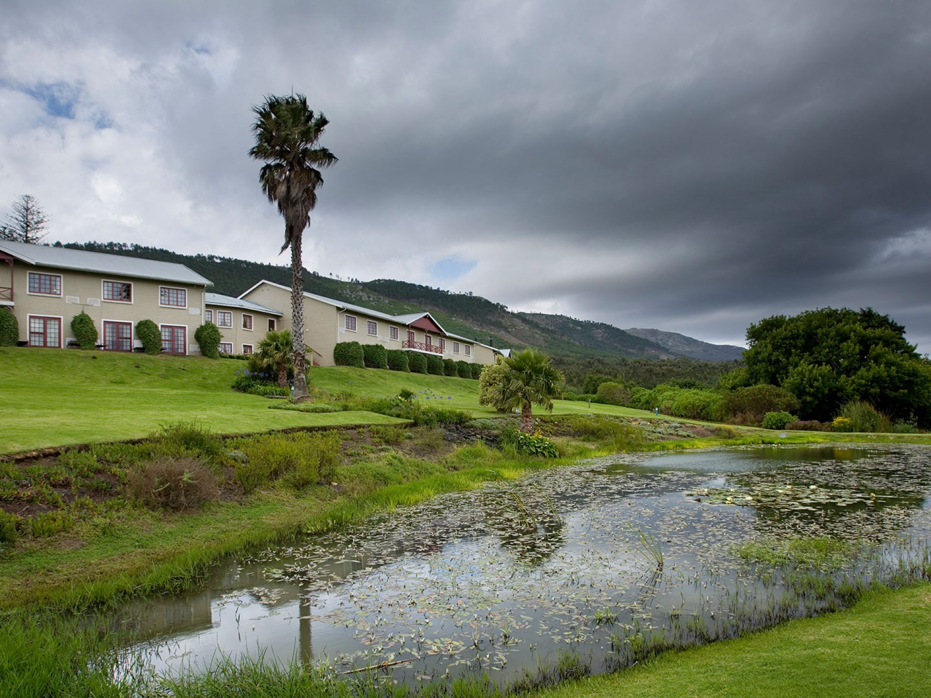 View of the Caledon hotel and gardens on a stormy day
