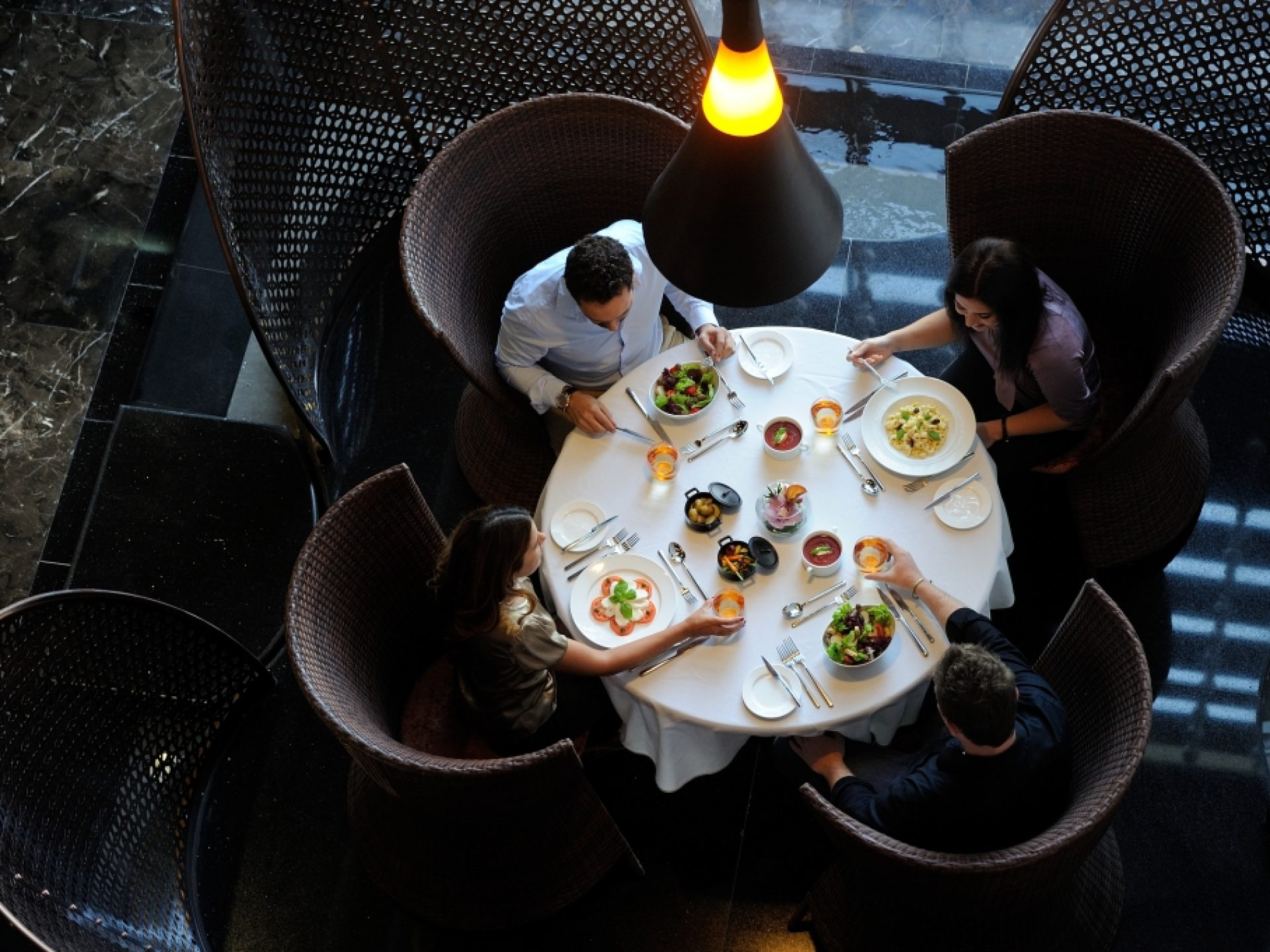 Aerial View Of 4 People Dining At The Foundry