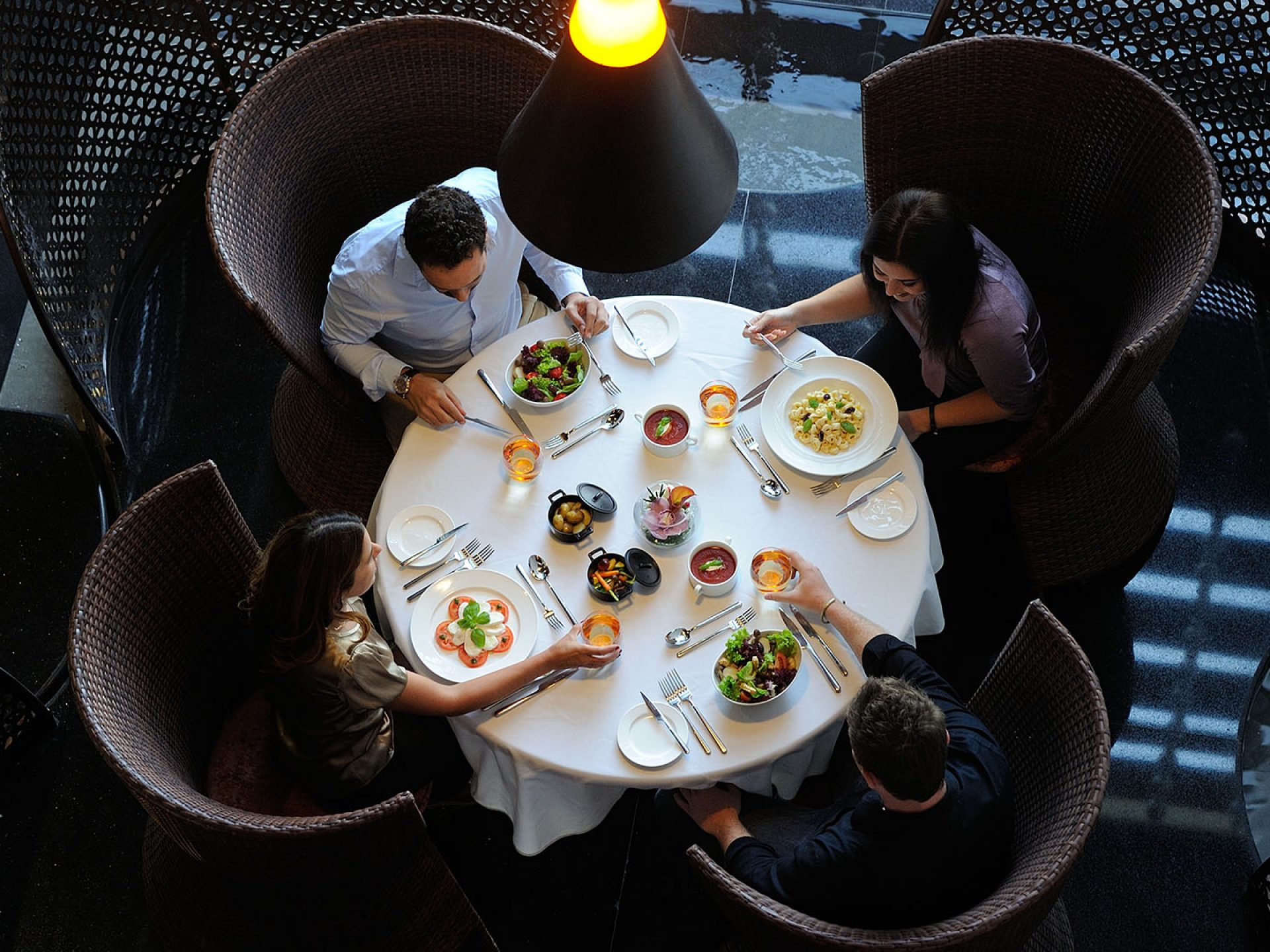 Aerial View Of People At Table In Restaurant
