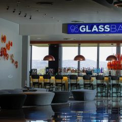 Interior Of Glass Bar Showing The Logo Above The Bar