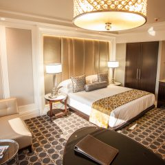 Bedroom With Seating Area At The Sandton Sun Hotel