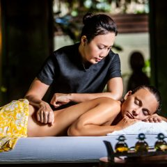 Spa Therapist Giving A Woman A Massage