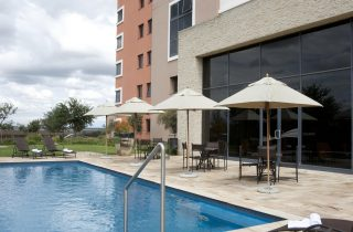StayEasy Emalahleni hotel exterior and pool area