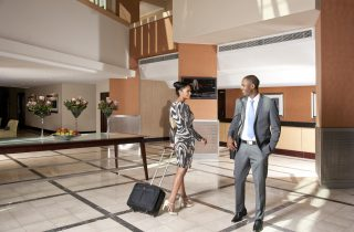 Couple in reception and lobby area