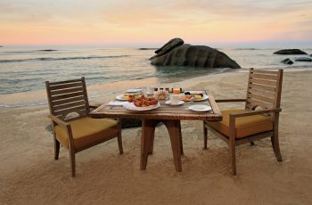 Table And Chairs Set For Breakfast On The Beach