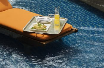 Deckchair In Pool With Tray Of Refreashments