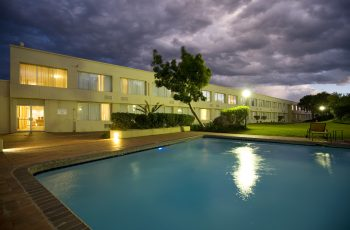 Garden Court Mthatha Pool and Exterior view at night