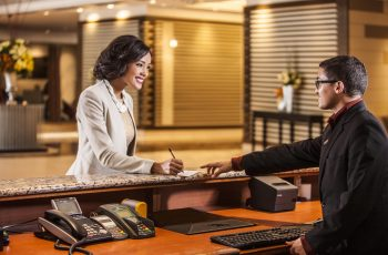 Woman checking in at reception at Southern Sun Waterfront