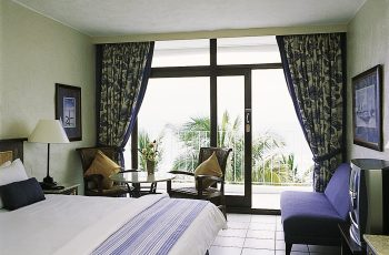 A bedroom with ocean view at the uMhlanga Sands Resort