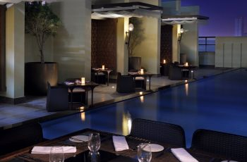 Tables Round The Pool At The Balcon Lounge and Terrace