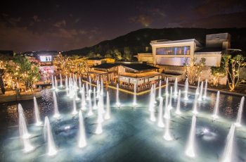 Exterior and fountains at night