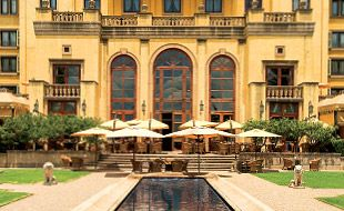 Palazzo Hotel Exterior With Terrace And Koi Pond
