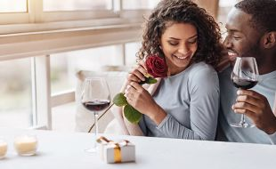 Valentines Day, couple enjoying a glass of wine