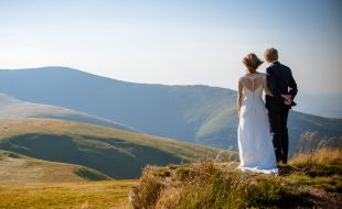 Newly wed couple enjoying the view at their wedding