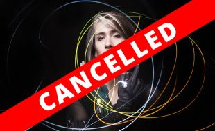 Imogen Heap with a cancelled on the event banner