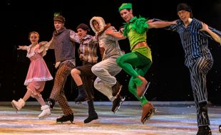 A Group Of People Skating On Ice And Performing On A Stage for the Peter Pan On Ice show